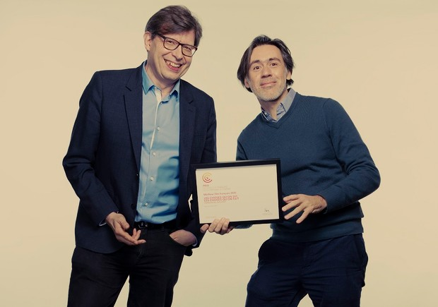 Association of French Film Critics president Philippe Rouyer and director Emmanuel Mouret with his prize for Love Affair(s)